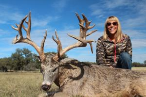 Jamie Silva with her 208 gross score Trophy Whitetail Buck.