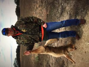 Anthony with a Coyote caught during their stay.