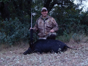 Ivey with his pig taken on the hunt.