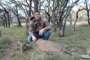 Jake Corley with his doe and first whitetail ever.