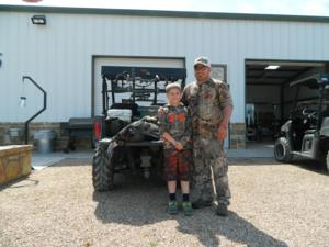Father and son enjoying a great hunting trip together.
