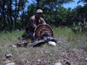 Jesse Silva with his well deserved first Gobbler and with a bow!