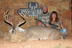 Jill Guillory with her Trophy 171 inch 12 point buck and her Trophy Husband Jeremy.