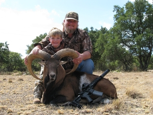 Easton, Jamie, and Jesse Silva of Colorado, with Moms huge Red Sheep!