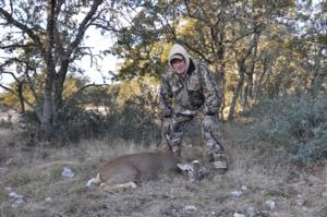 Buck with his second doe of the hunt.