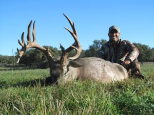 Heavy 170 inch 15pt Trophy buck taken by Evan Lamoreux.