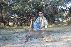 Forest Hoffman with his doe taken at the Cross Oaks Ranch.