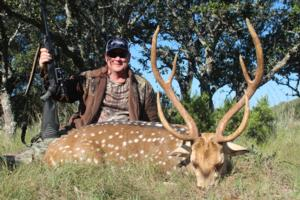 <p>Johnny Downs made a great shot on this Axis buck with huge eye guards.</p>