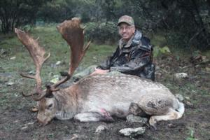 Bernie White of Mississippi took this Fallow Buck after a long stalk in the rain!